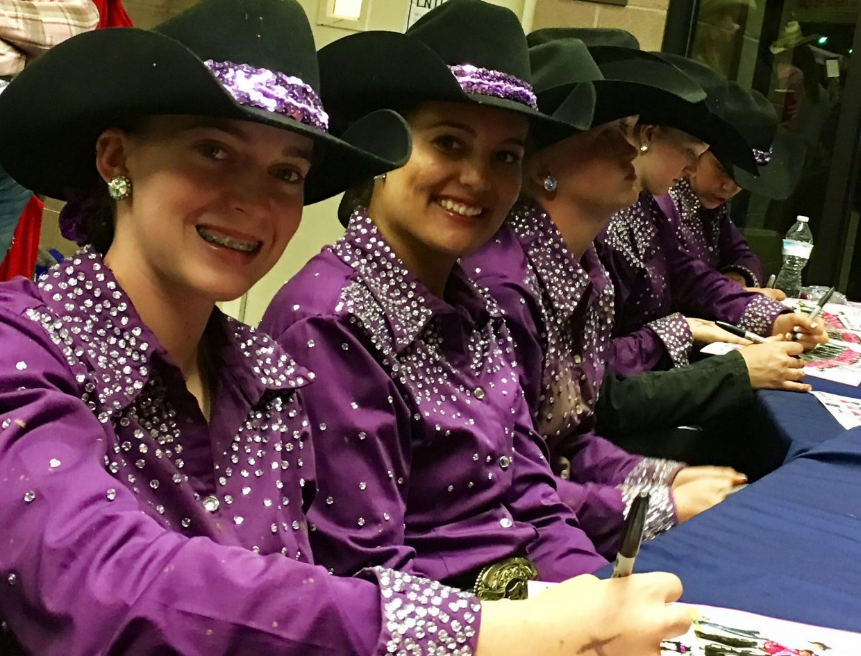 """""""May I please have your autograph?"""" Rangerettes oblige young fans as, left to right, Sydney Nelson, Krista Davis and teammates sign programs after the Saturday night finals at the 2017 Pikes Peak or Bust Rodeo."""