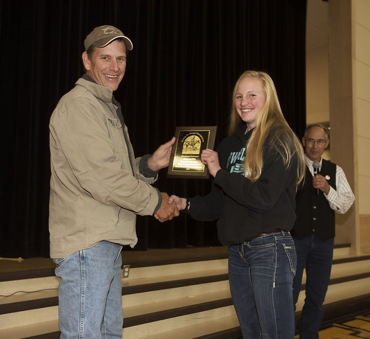 Overall high-scoring individual, Ainlsey Powell from the Merino FFA chapter, receives her award from Colorado Society for Range Management president Josh Saunders. The plaque was sponsored by the Colorado Society for Range Management.