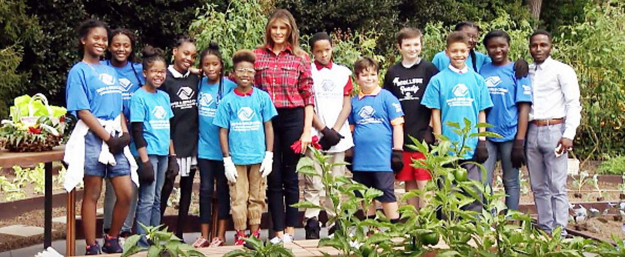First Lady Melania Trump poses with children from the Boys and Girls Club of Washington in the White House kitchen garden on Sept. 22.