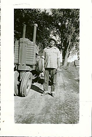"""Charles """"Chuck"""" Nelson works on the Nelson family farm east of Longmont, Colo., circa 1952."""