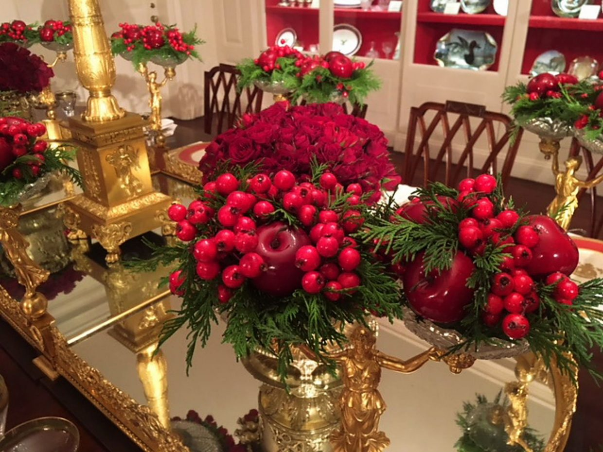 The centerpiece on the table in the China Room for the holidays is resplendent in red.