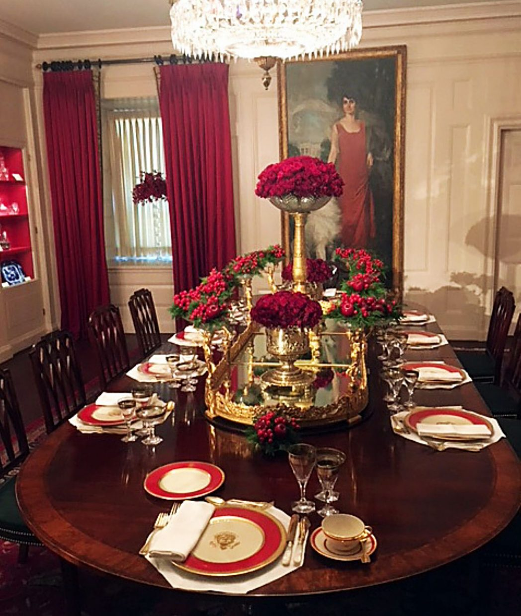 The China Room is set with the first china service made especially for the White House, commissioned by President James Monroe in 1817. In background is a portrait of First Lady Grace Coolidge.