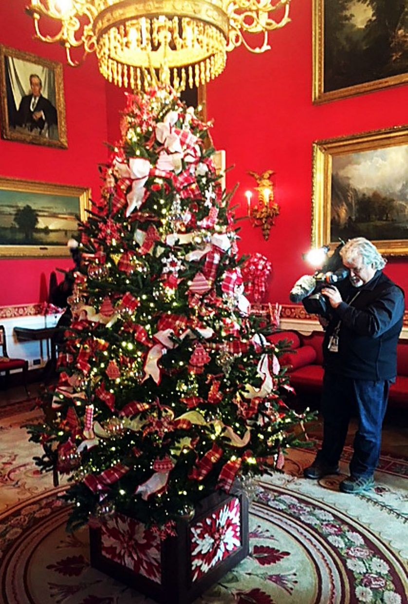 The tree at the center of the Red Room is adorned with cookies, tied with red bows and