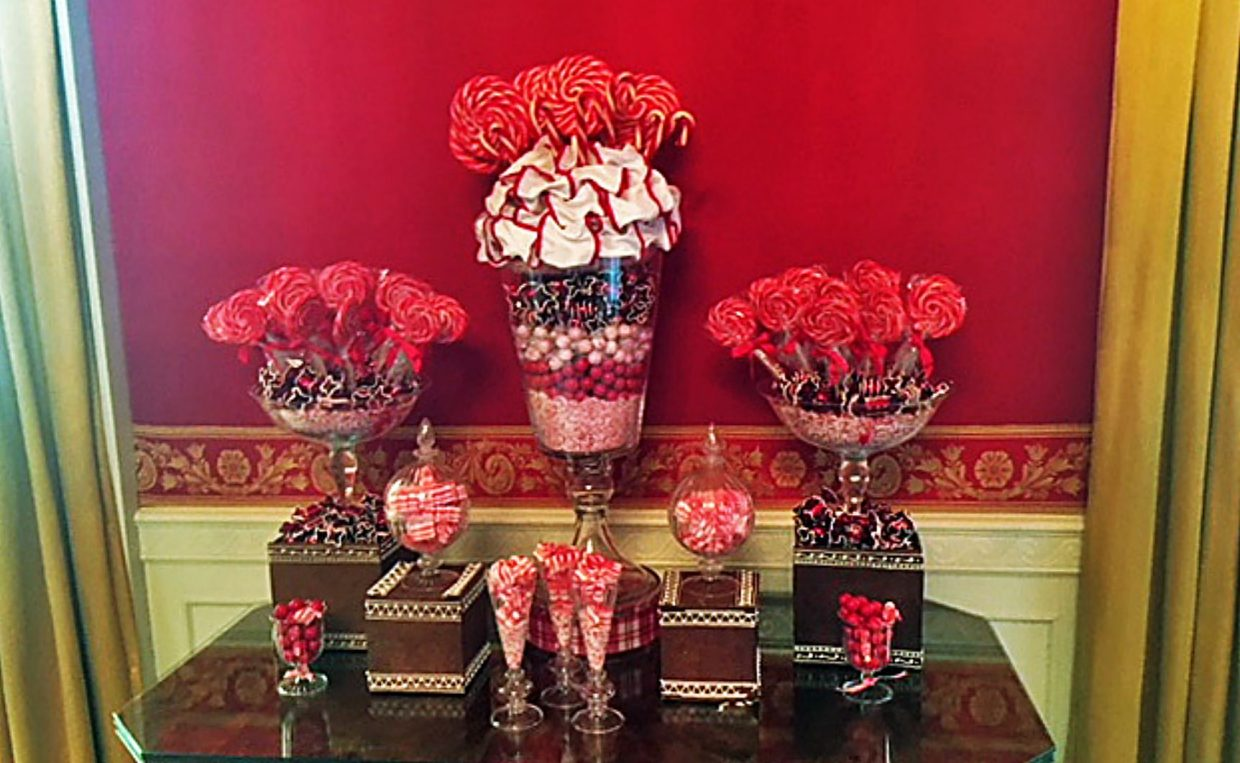 The Red Room includes red and white striped ribbon candy impersonates dishes of ice cream.