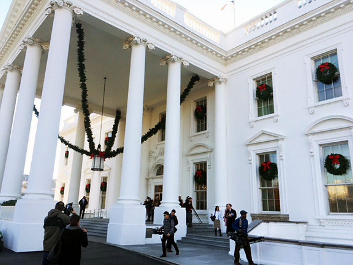 The White House North Portico and windows with wreathes designed by First Lady Melania Trump.
