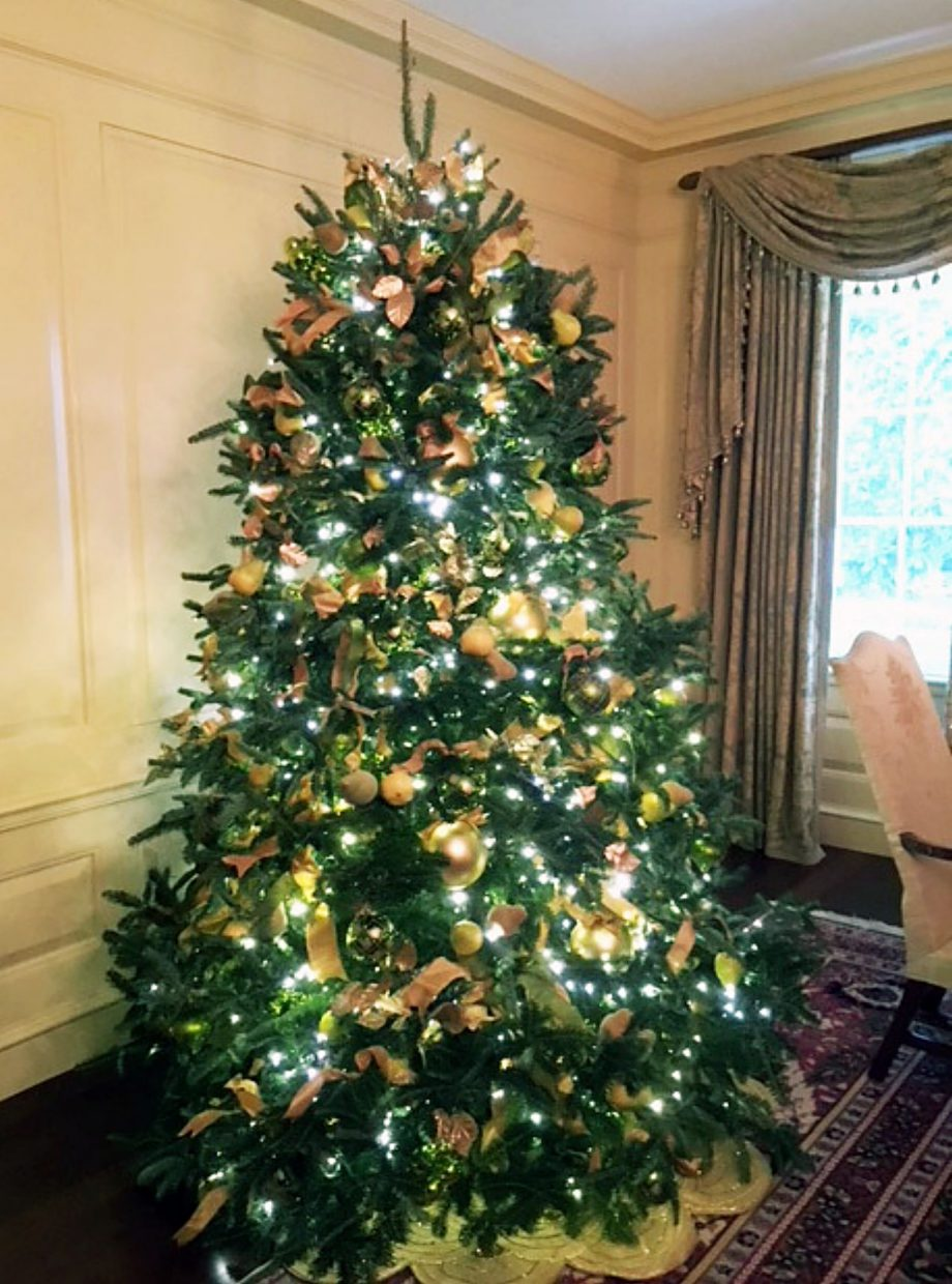 The Vermeil Room, which features hues of gold, yellow and green, is decorated with pears on the tree.