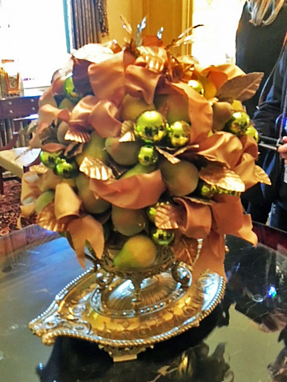 The Vermeil Room, which features hues of gold, yellow and green, is decorated with pears in a festive beribboned arrangement on a table