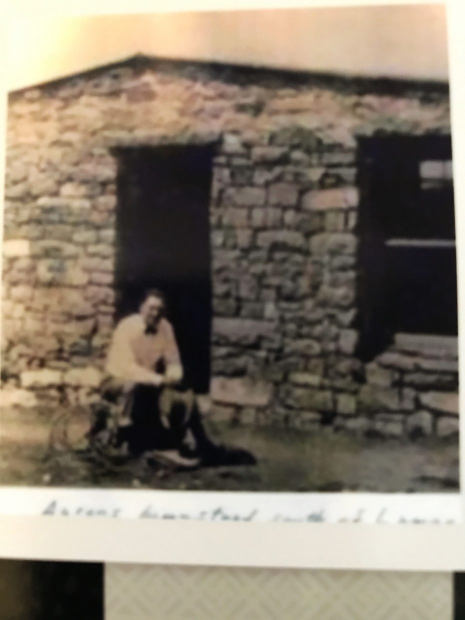 A photo of Aaron Emick in front of the original homestead.