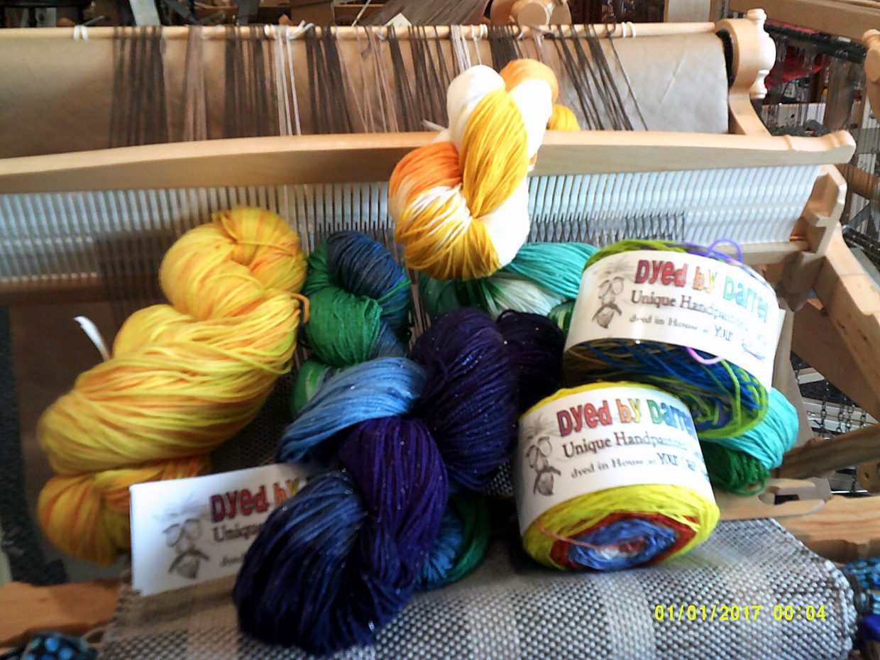 A loom at Your Daily Fiber holds some of Darrell Sipes hand-dyed creations. In addition to yarns, the store carries spinning wheels, looms and most knitting/crocheting equipment.