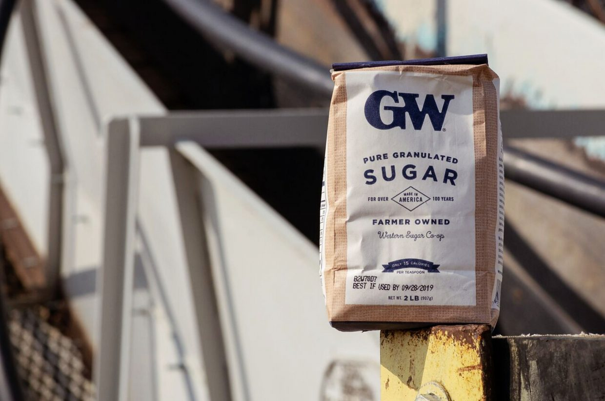 A 2-pound bag of GW sugar sits on a sugar beet sorter. Sugar beets are harvested from September through November and processed into white sugar crystals until February.