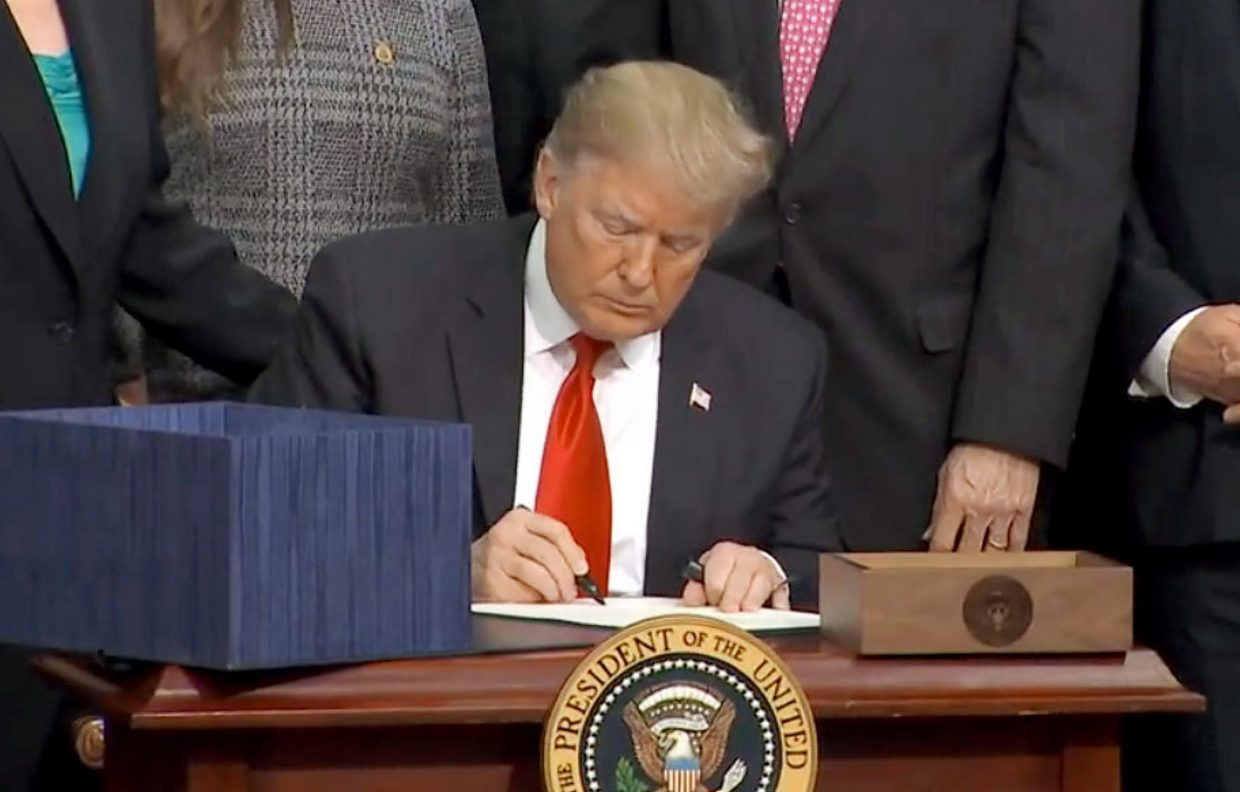 President Donald Trump signing the five-year farm bill on Dec. 20.