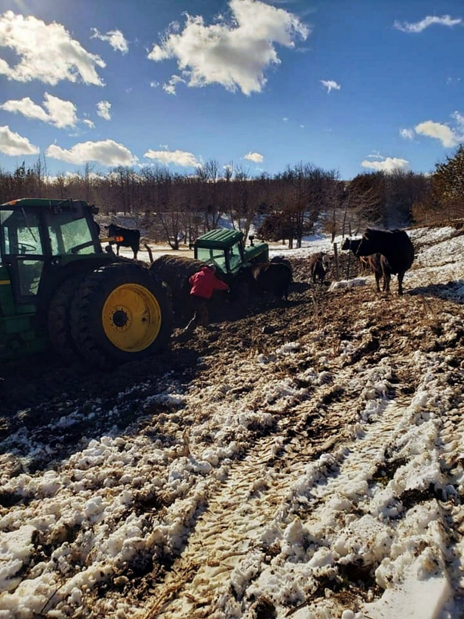 Attempting to pull a tractor out of the mud.