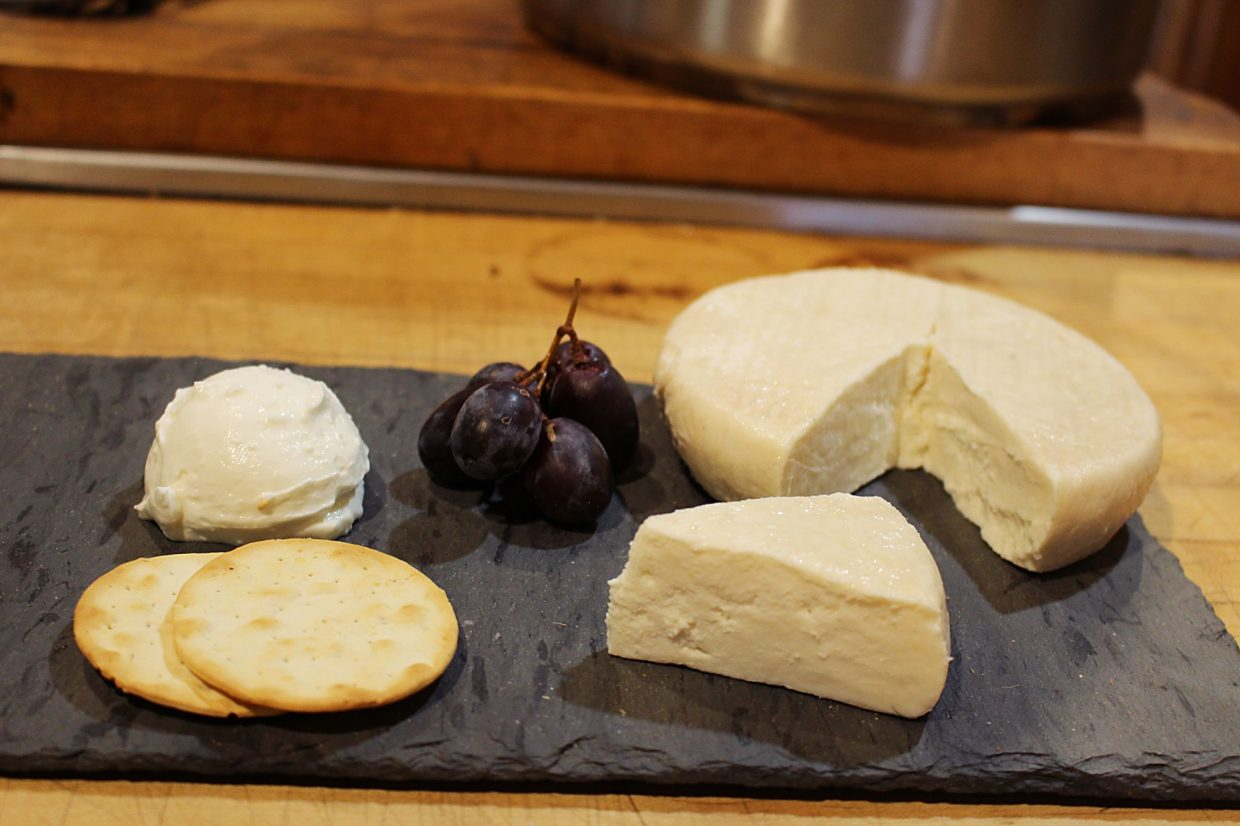 From left, Gordon Chavis's Chevre cheese sets beside his specialty Black Goat Muenster, named in honor of his 'powerhouse milker', Izzy. At her peak, Izzy gives almost one and a half gallons a day